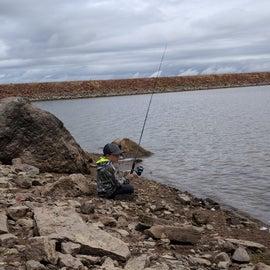 My son fishing off bay