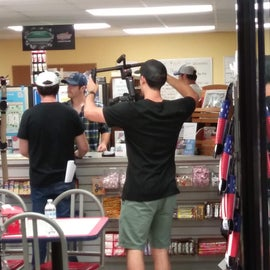 Student film crew filming in the store.