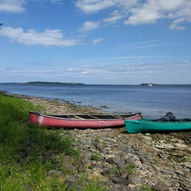 The shoreline and our boats down a path from campsite T07
