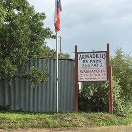 The Armadillo RV Park sign near the entrance