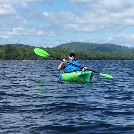Enjoying kayaking on the lake.