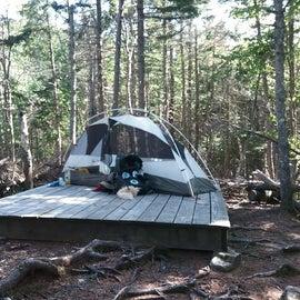 Tent platform outside of hut