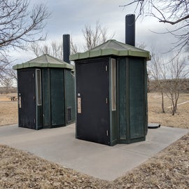 Pit toilets are clean and well stocked.