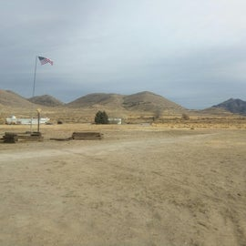 Shot of the flag pole, surrounded by 50A outlets, and the field beyond which has 30A scattered.