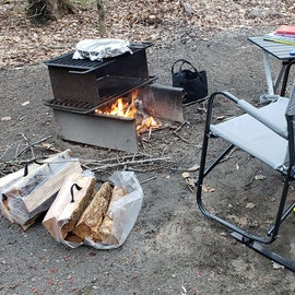 Enjoying dinner and a fire before the rainstorm! The campground host offered to deliver the firewood to me.
