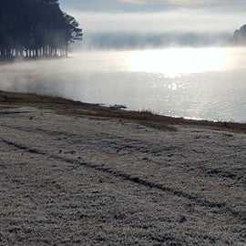 Unexpected major temp drop, expected mid thirties but it was 25 at daybreak. Woke up to frost on the ground and mist over the warmer water.