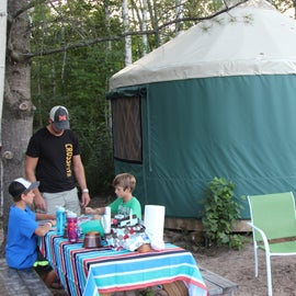 Our Yurt, with fire pit, picnic table, and grill.