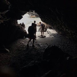 Cave that runs off of the black sand beach to the ocean