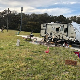 Our site. We had a decent amount of space being an end unit. See how long the sites are? That was as far back as we could go because of the hook-ups being so close to the front. No shade, but decent field space out back to run around.