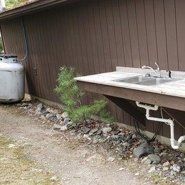 Dishwashing sink outside the bathrooms