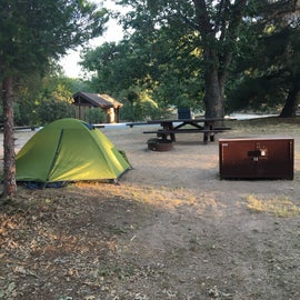 Our campsite with our food storage and conveniently located bathroom to the upper left