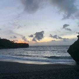 the black sand beach at sunrise