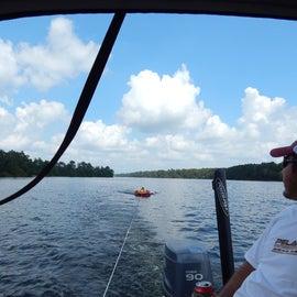 Tubing behind boat in lake
