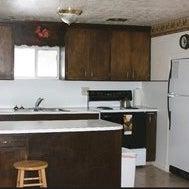 Kitchen includes dishes,pots,pans etc