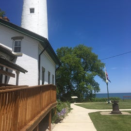 You are right next to the lighthouse and can walk along the water to see the museum and grounds. Very pretty!