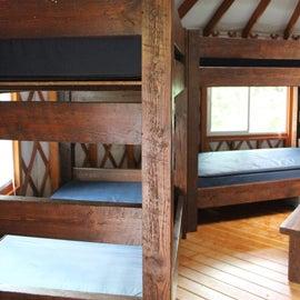 Sets of bunk beds. Each yurt sleeps 7