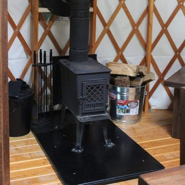 Wood burning stove in the yurt. Wood provided by the park!