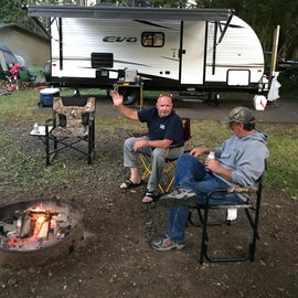 Jerry and Steve enjoying a cold one, and behind them my 2020 forest river Evo trailer .