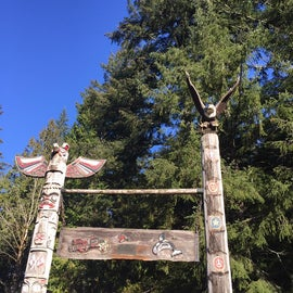 These totem poles are located next to the parking lot at Camp Thundirbird.