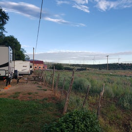 Facing northwest, tent pads to the left of the fence, facing windmills.