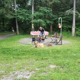 Cooking area with fire ring, picnic table, and lantern hook.