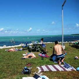 It was very cold for swimming so we mostly laid out on the grassy dock areas.  There wasn't much sand beaches
