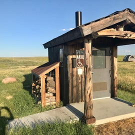 Vault toilets at the edge of each loop with firewood