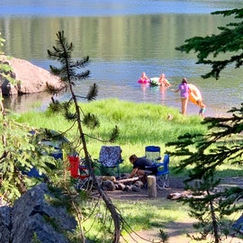 Site is right below the road. Right on the lake with a large area for tents, two picnic tables and also a rock fire pit.