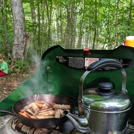 Cooking breakfast outdoors is one of my favorite camping things.
