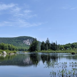 View of Marshfield Pond while biking on the Cross VT Trail, which is accessible directly from Kettle Pond State Park.