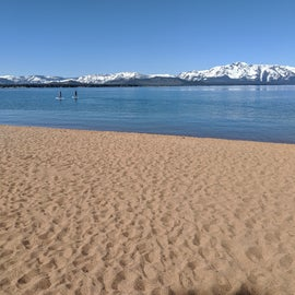 Beautiful beach with view of an snow cap mountains