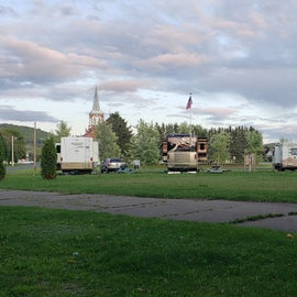 view from back of campground toward town. Hookups are on posts between two sites