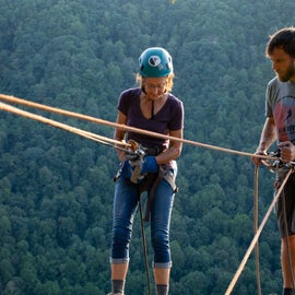 Rappelling from a cliff on the Bridge Buttress Trail