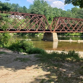 The railroad bridge marks the edge of the campground