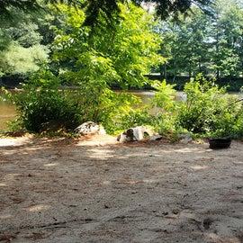 Sandy riverfront campsite