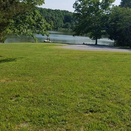 There is a large grassy area between the entry point and the boat ramp that can be used for large group gatherings.