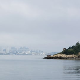 The ferry to Peddocks Island passes Long Island and, on this morning, a foggy view back toward Boston.