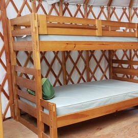 Yurt interior. There are two sets of bunks.