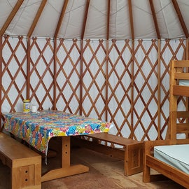 Yurts are furnished with 2 sets of bunks, a table and benches