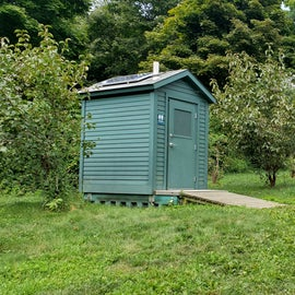 Walking up the hill to yurts 1-6 you'll pass a composting toilet and water faucet on the left