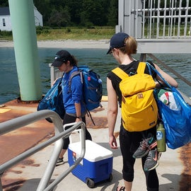 Campers heading to the ferry with their gear
