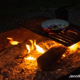 Really nice adjustable fire pit grill.