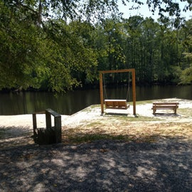 Lovely swinging bench by the river