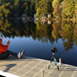 My wife sitting on the dock as I begin taking some foliage shots of the beautiful shoreline.
