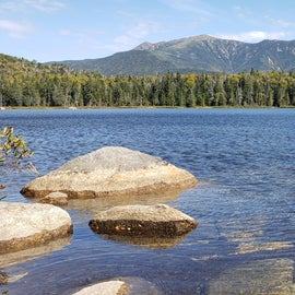 View from Franconia Ridge from the shore of Lonesome Lake below the hut