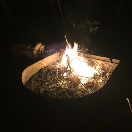 Enclosed fire ring with grill