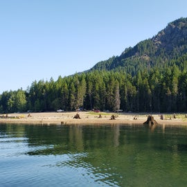 Low water level in August.  A lot of stumps.  You can see the campers along the shore