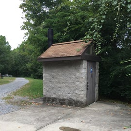 The pit toilet near the pavilion and campground