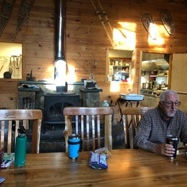 """Main """"hut"""" has shared dining and relaxing spaces"""