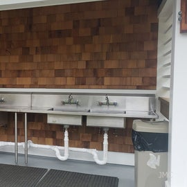 Dishwashing sinks at the end of the new bathhouse